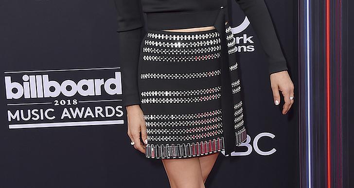 Mila Kunis på röda mattan under Billboard Music Award 2018.